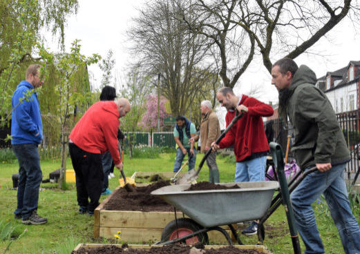group of service users taking part in a gardening session in north manchester